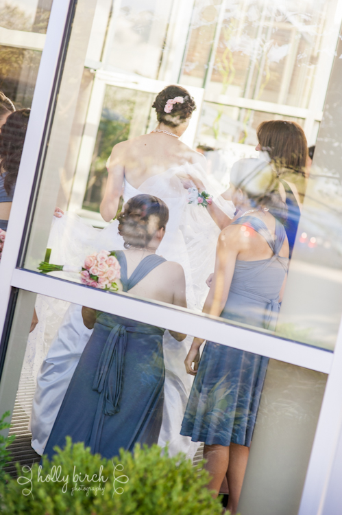 bustling the bride's dress