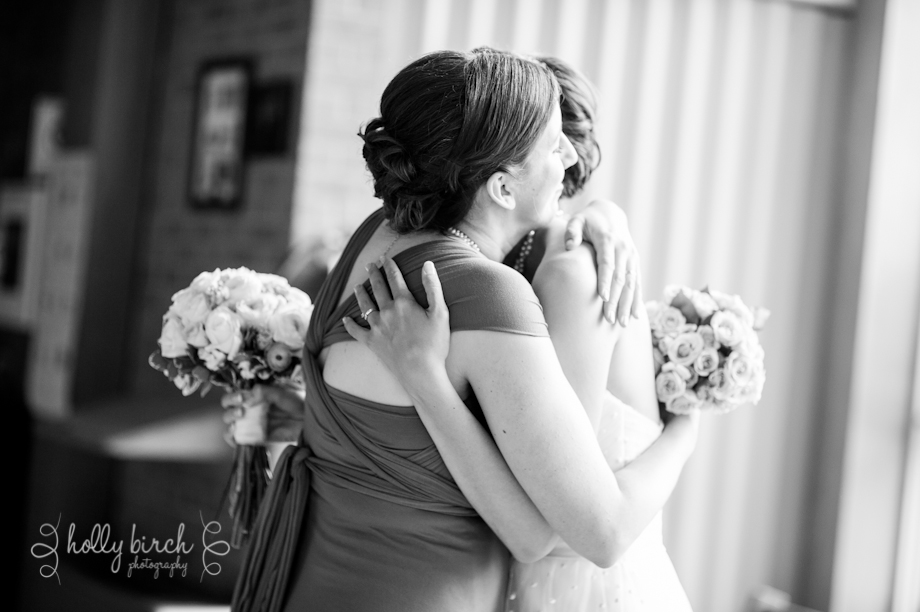 Bride maid of honor hug