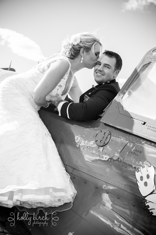 Bride and groom on plane wing
