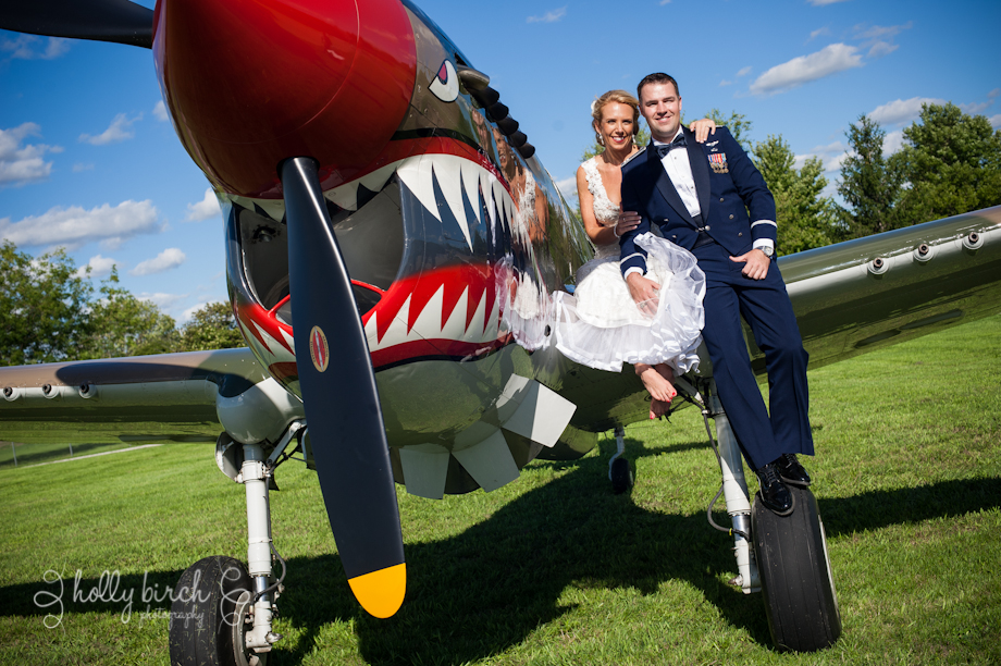 Bride and groom on plan wing