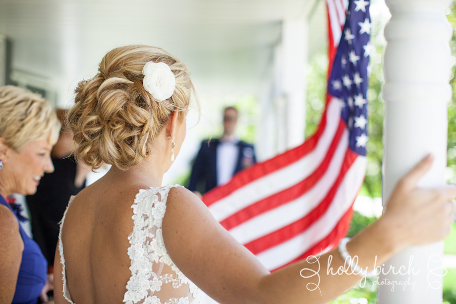 bride on front porch with American flag