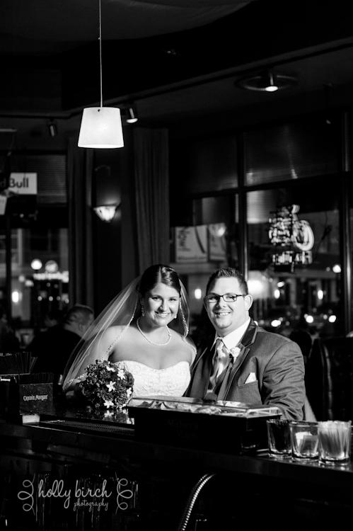 bride and groom at bar at Guido's
