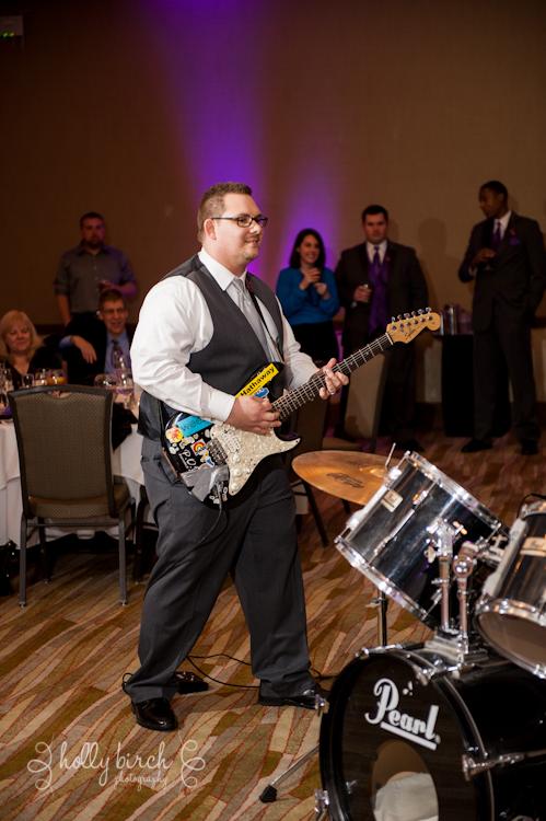 groom playing guitar for band Walt Flanagan