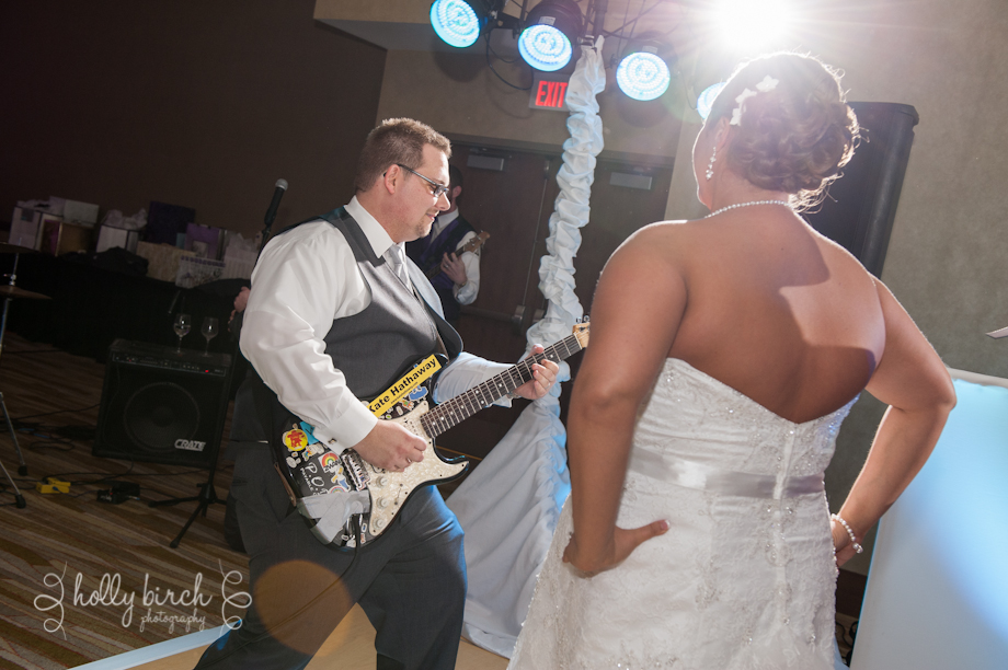 groom playing guitar for bride