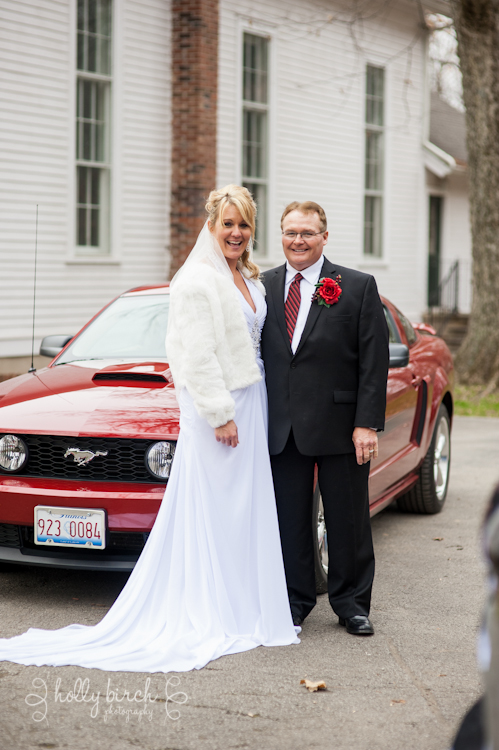 bride and groom with getaway Mustang car