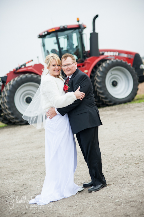 bride and groom with red tractor