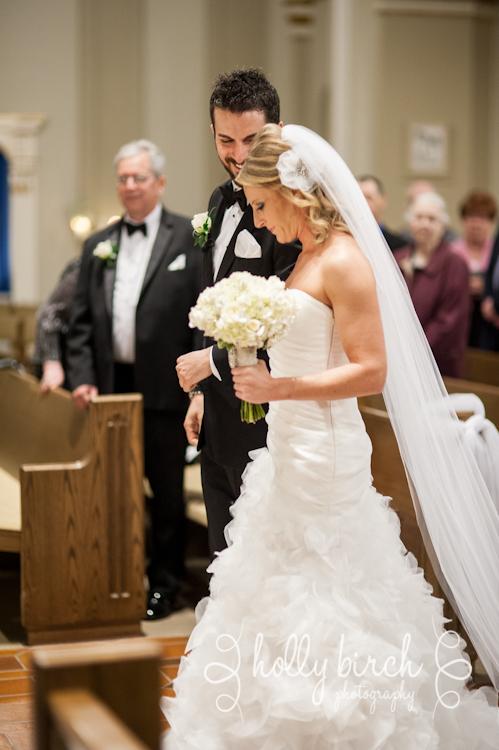 groom takes bride's arm