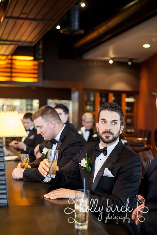 groomsmen hanging out in bar