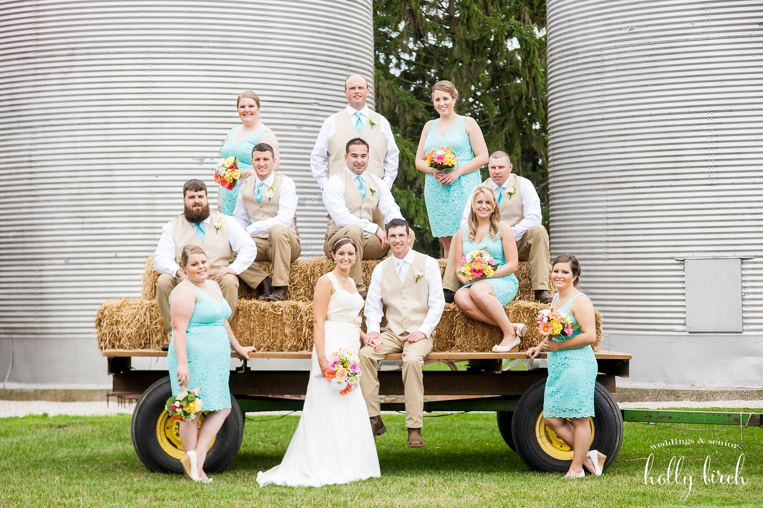 wedding party with straw bales and grain bins
