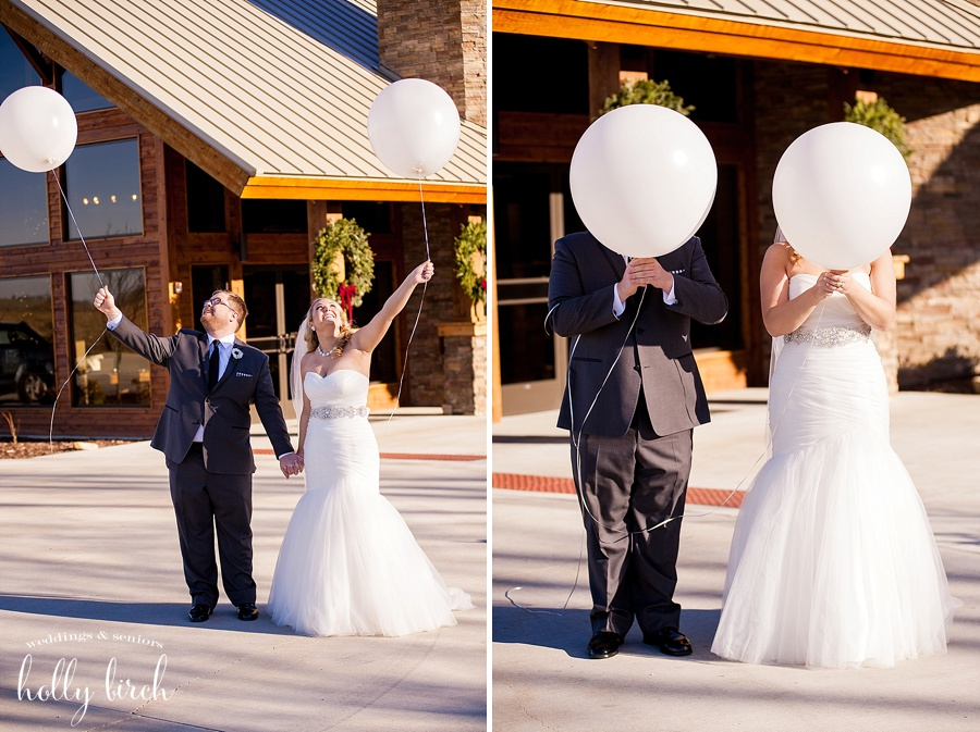 bride and groom with huge white balloons