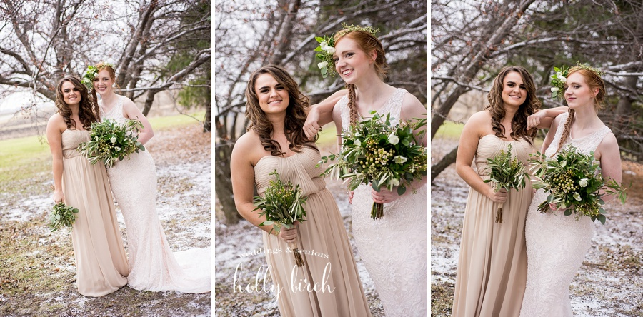bride and bridesmaid with light snowfall