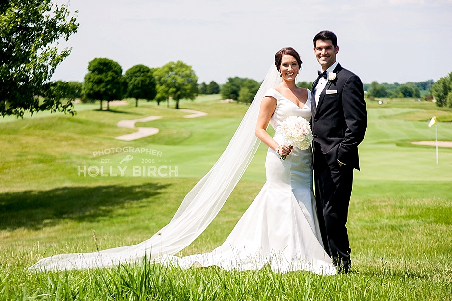 bride and groom on fairway green
