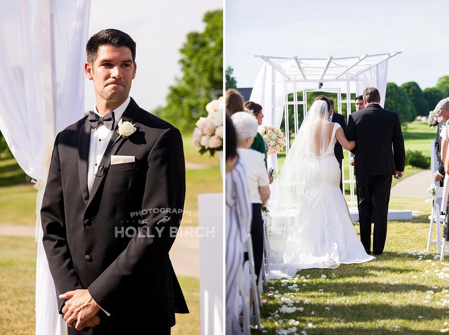 groom looking as bride walks down the aisle