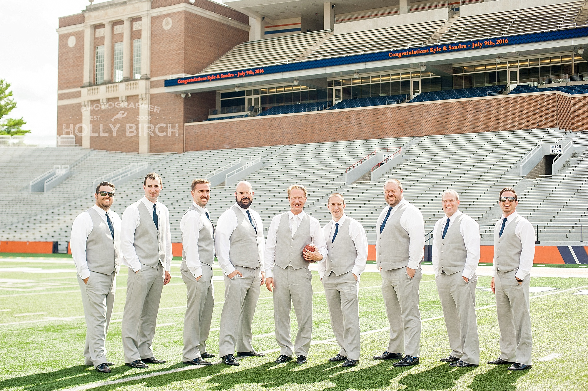 groomsmen on football field