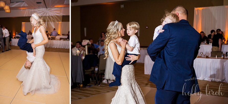 bride and groom dancing with their children