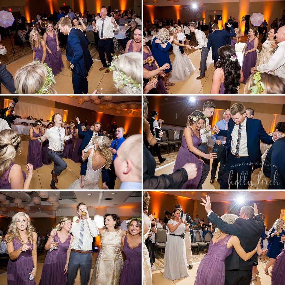 wedding dancing candid photos with amber uplighting