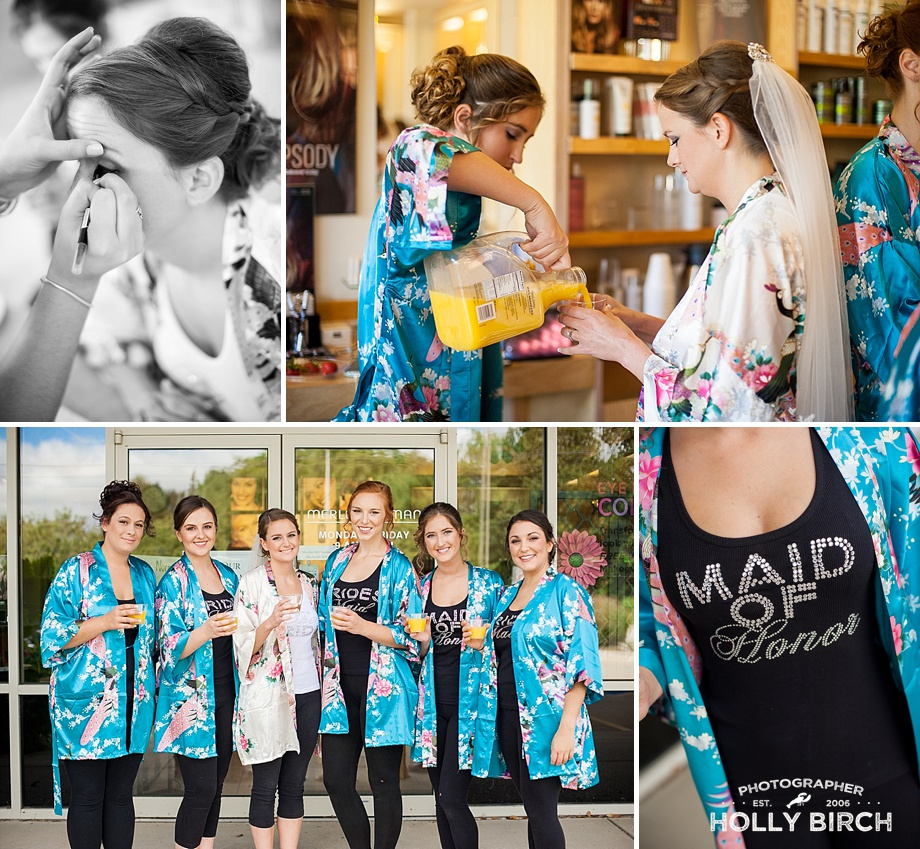 bridesmaids in teal robes with mimosas