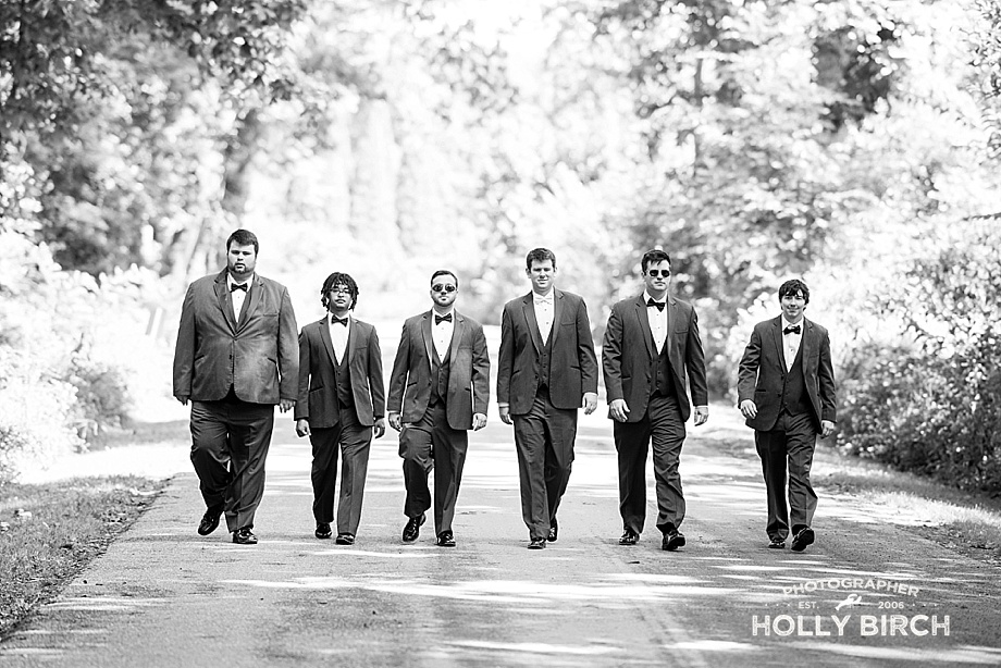 groomsmen walking down dirt road