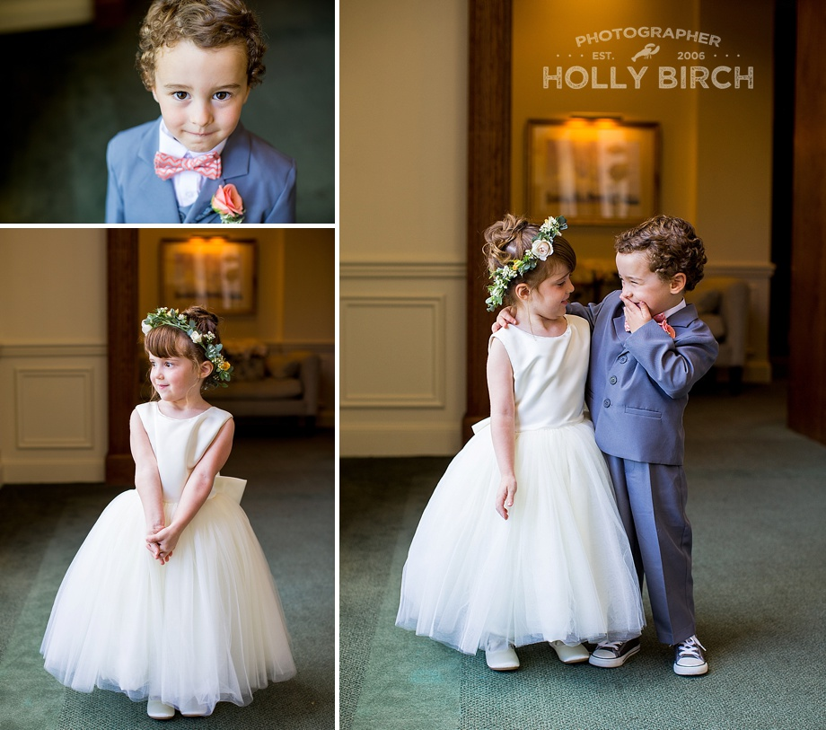 adorable ring bearer and flower girl giggling