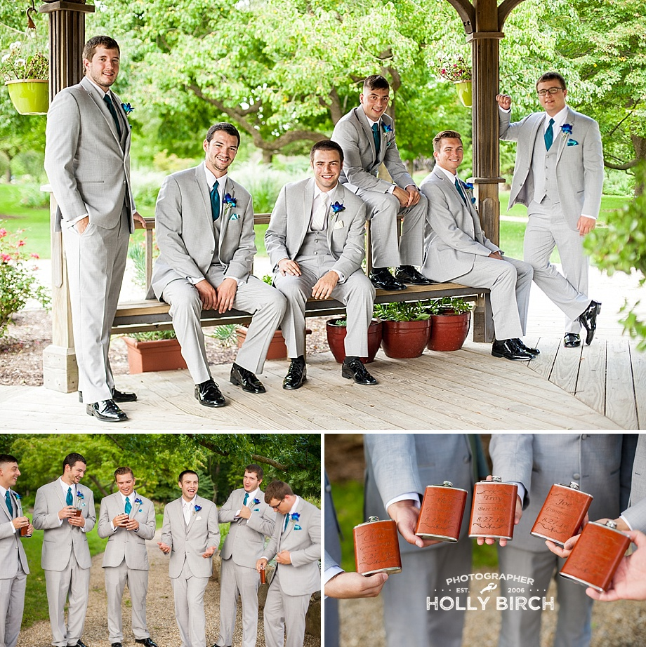 groomsmen in gray tuxes with leather personalized flasks