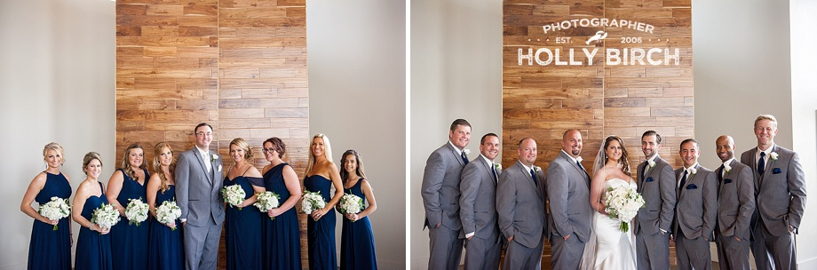 bridesmaids and groomsmen with hanging wood panels