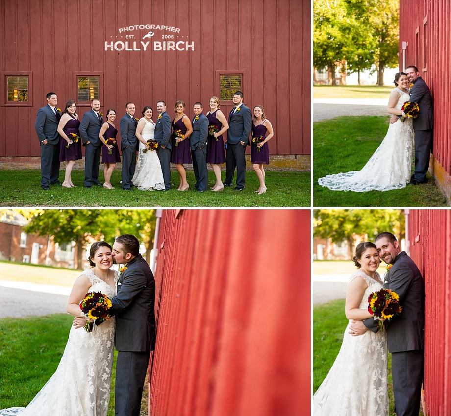 bride and groom beside old red barn
