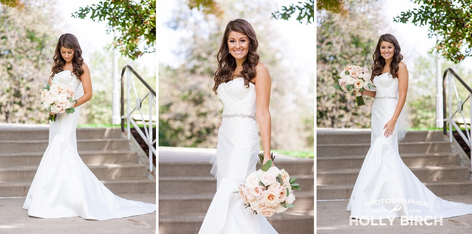 bride on stairs with white blush bouquet
