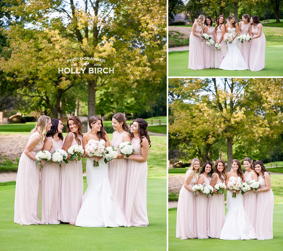 blush bridesmaids in cute pose