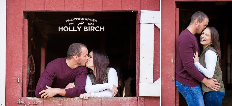 couple snuggling in horse barn