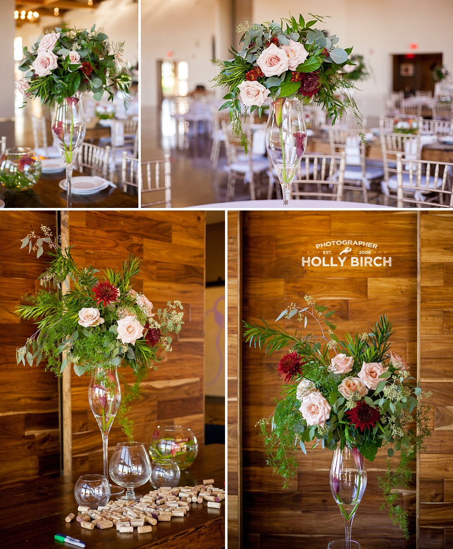 tall floral centerpieces with wood backdrops