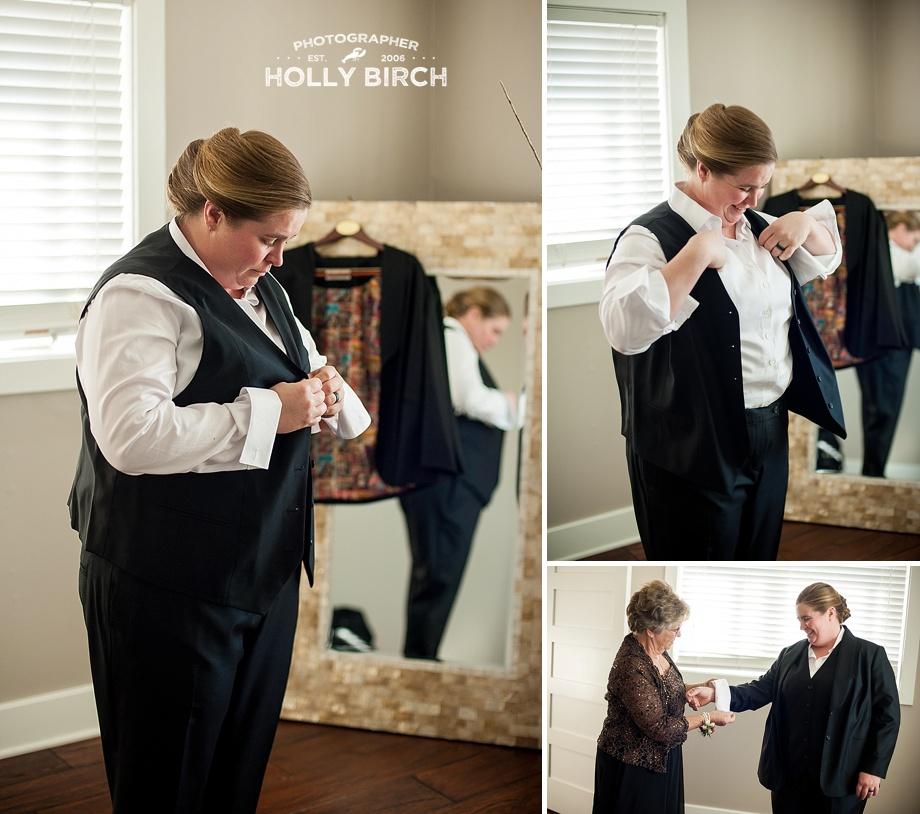 bride getting dressed in custom suit