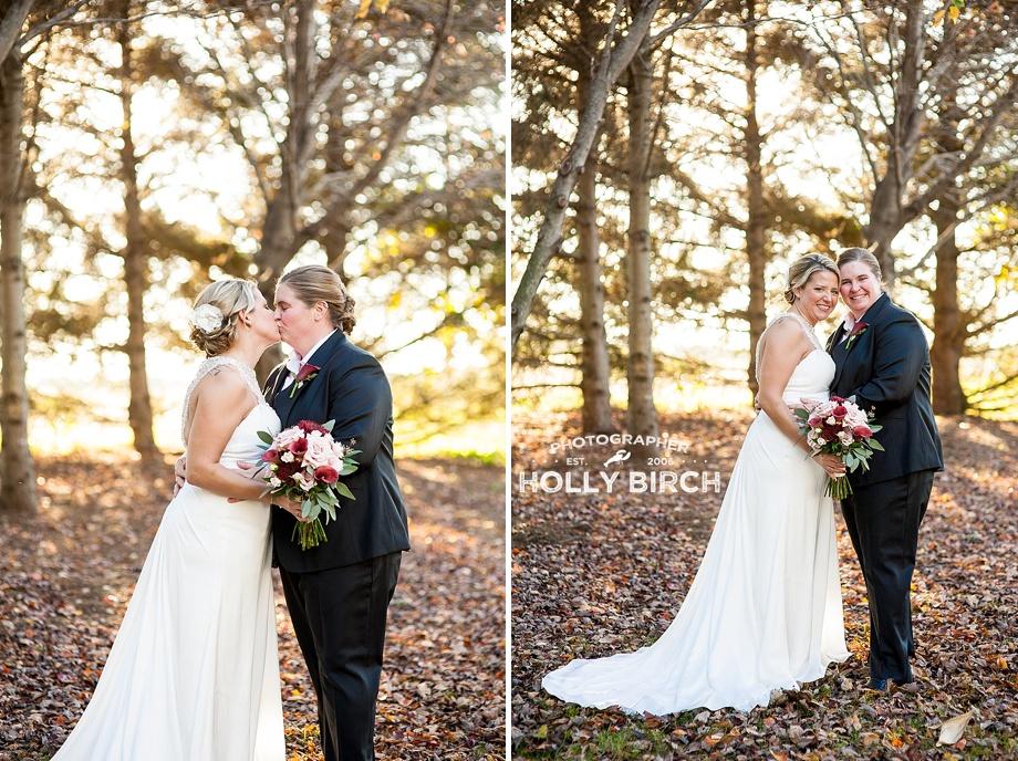 late fall wedding photos among tall trees