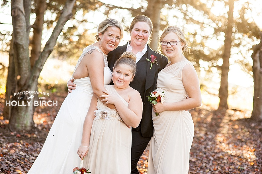 a newly formed family following wedding ceremony