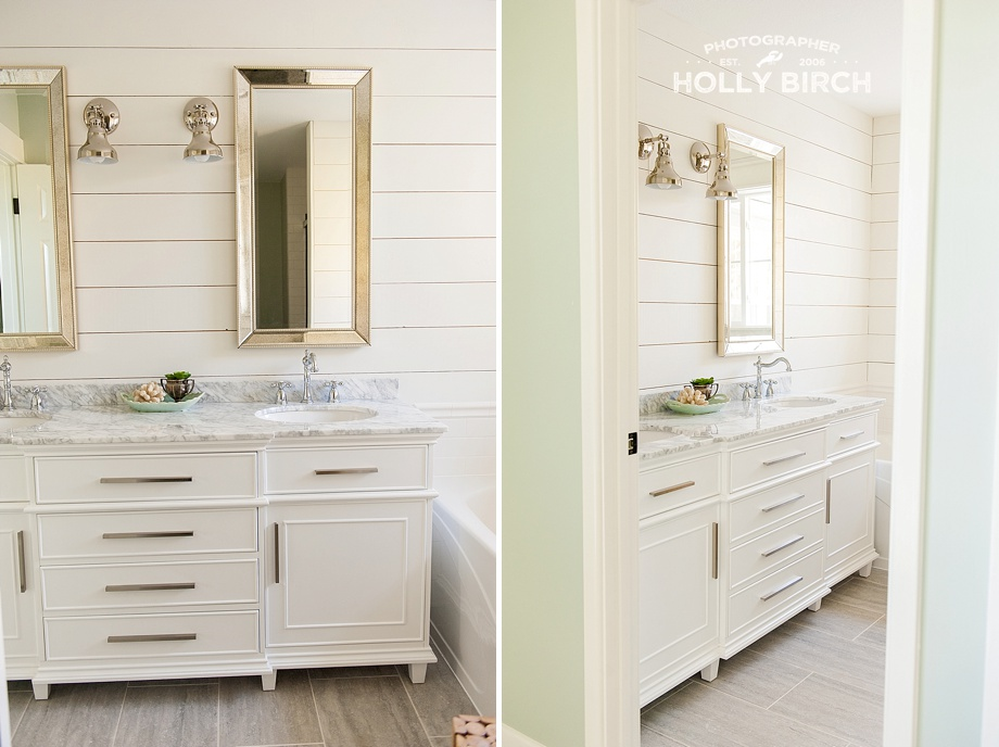 marble bathroom vanity with ornate mirrors