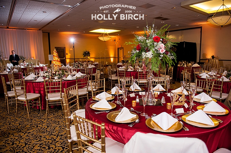 gold chiavari chairs with red tablecloths