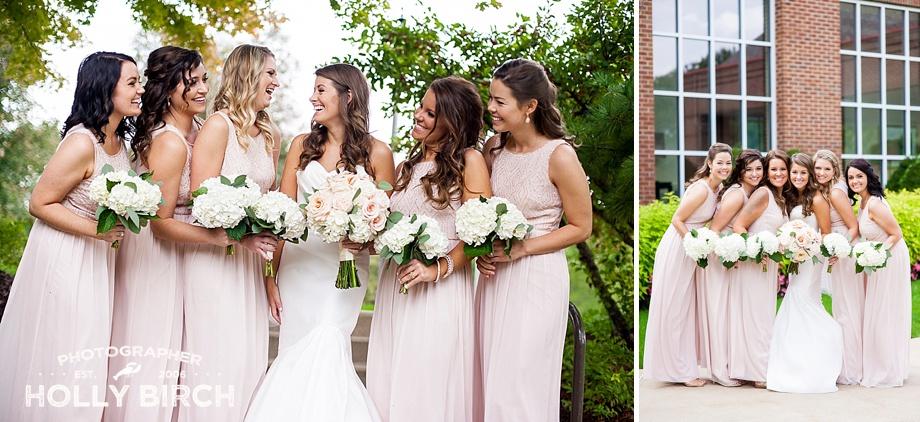 blush casual bridesmaids pose