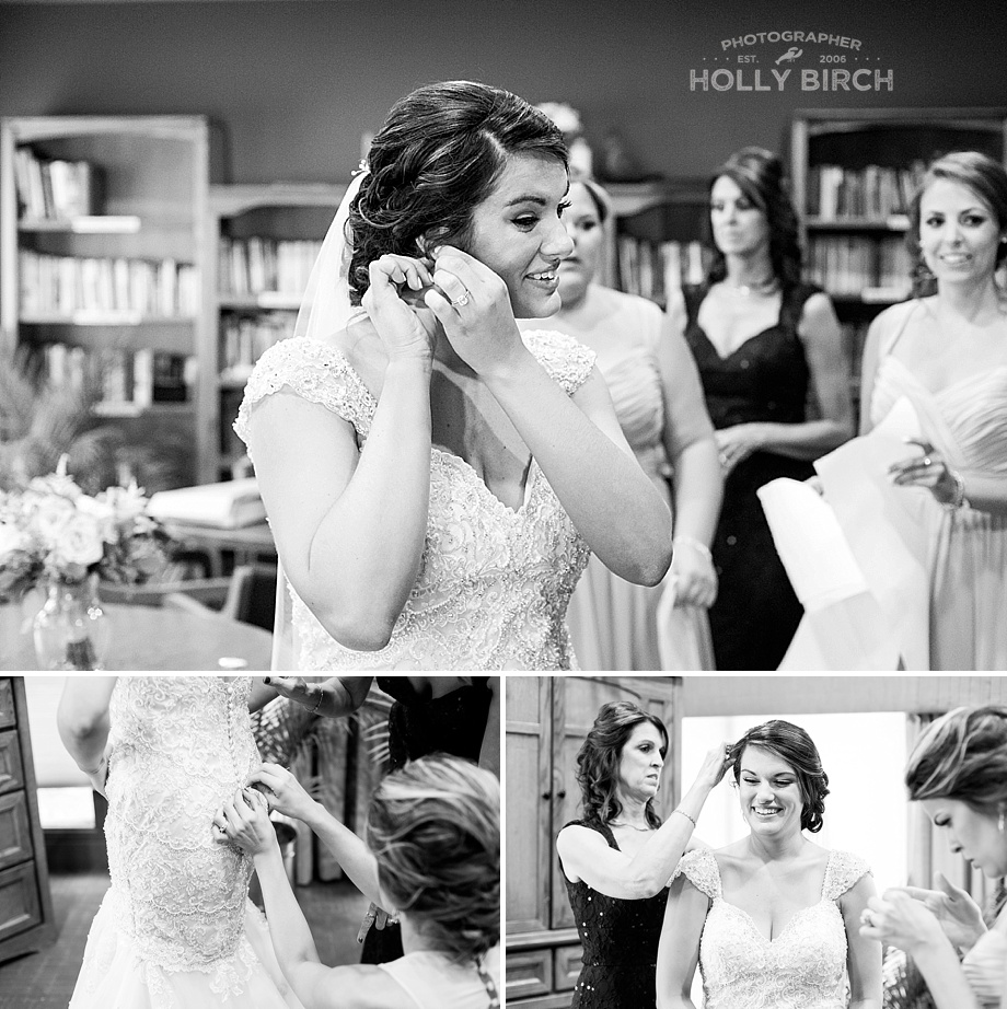 bride putting on finishing touches