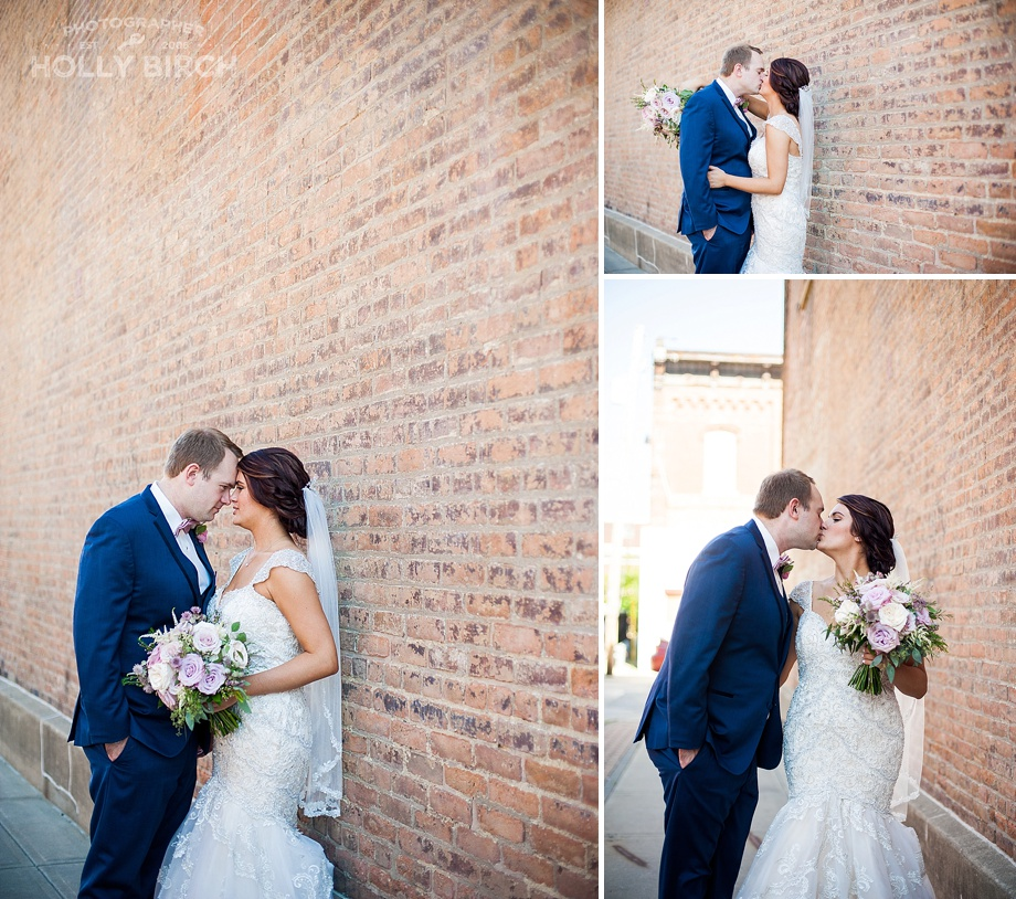 couple with brick wall in Champaign