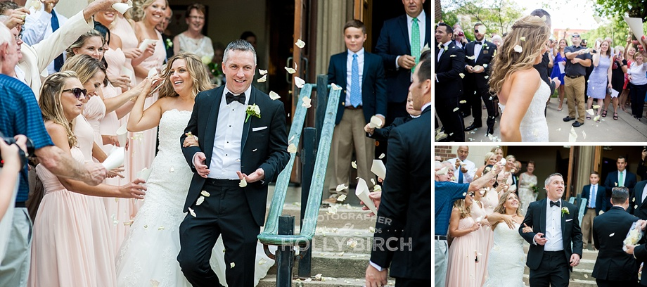 guests throwing petals as bride and groom exit