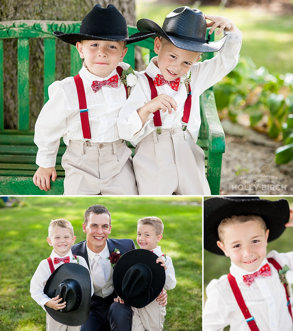 adorable ring bearers with red suspenders