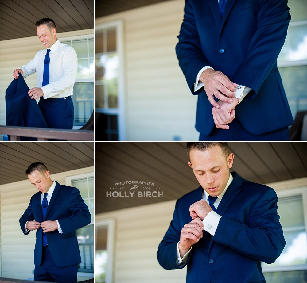groom putting on navy suit
