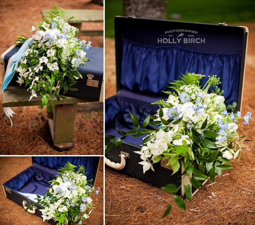 blue retro suitcase with floral bouquet