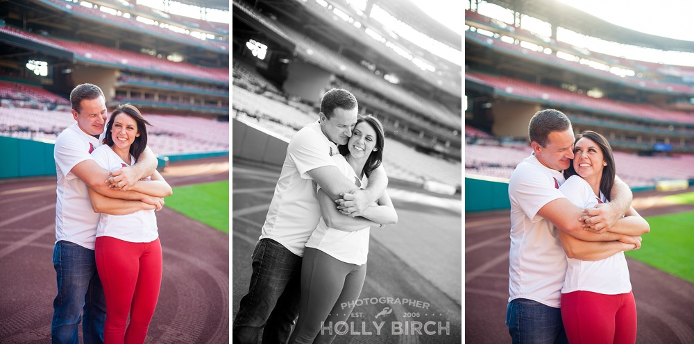 romantic couple pose on field at Busch Stadium