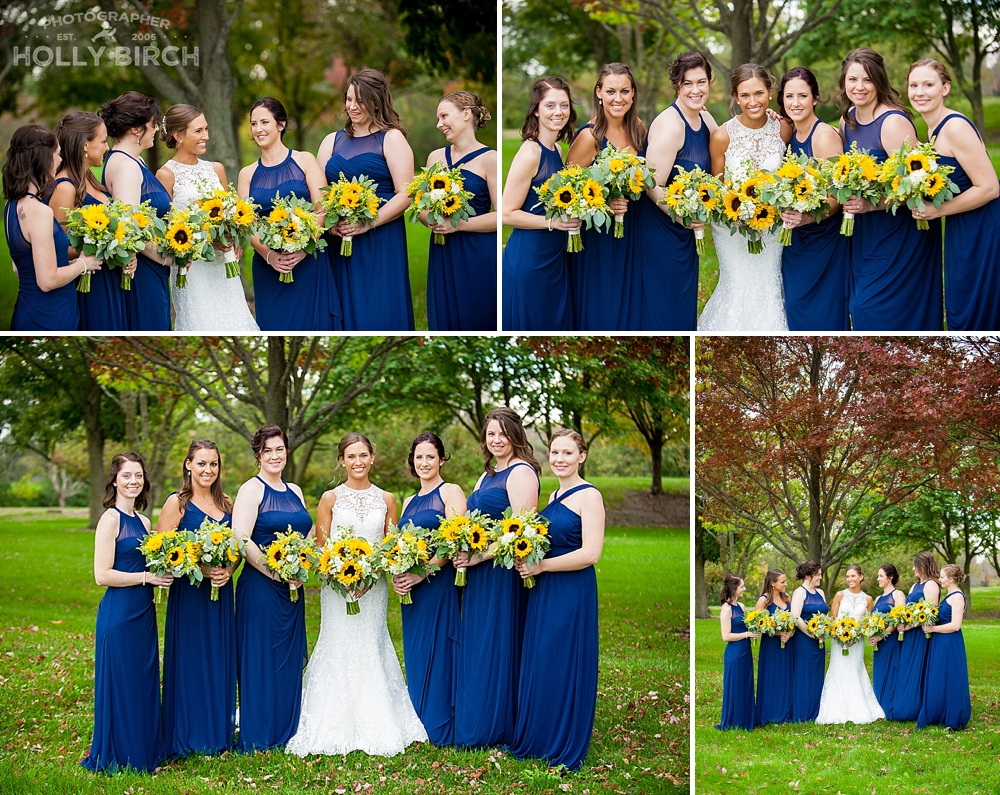navy bridesmaid dresses with sunflower bouquets