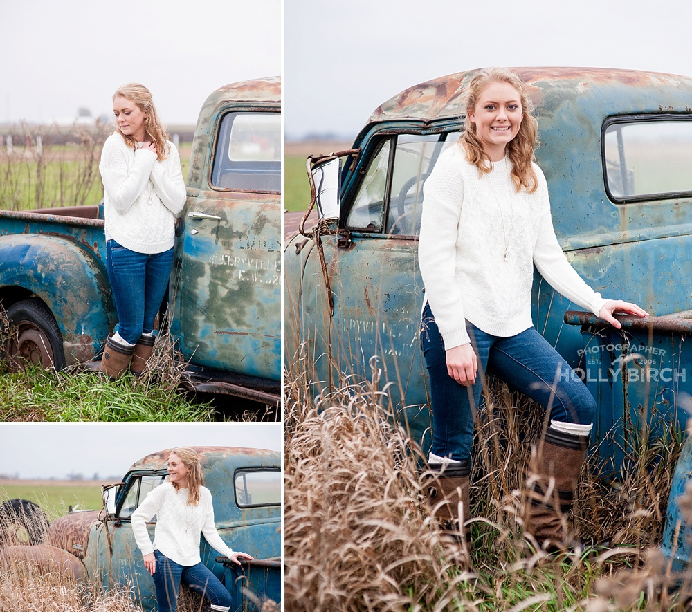 senior girl in white sweater with rusty blue truck