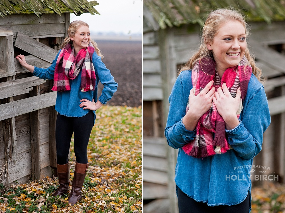 senior girl with chunky scarf and dilapidated building