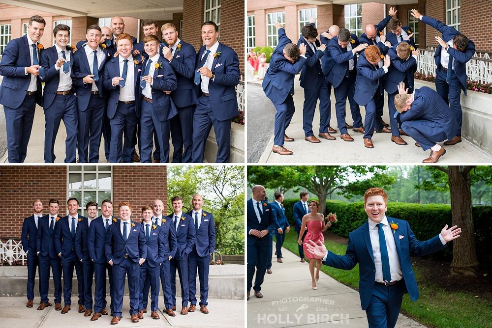 groomsmen in navy suits dabbing
