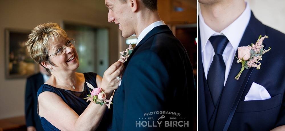 mother of groom putting on boutonneire