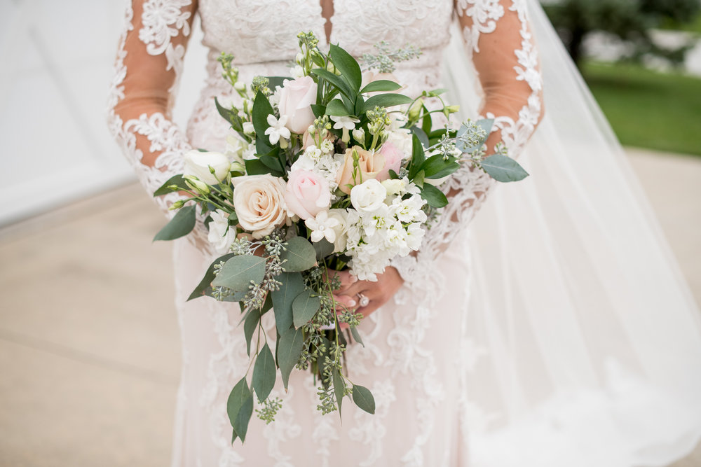 white pale pink bouquet with greenery