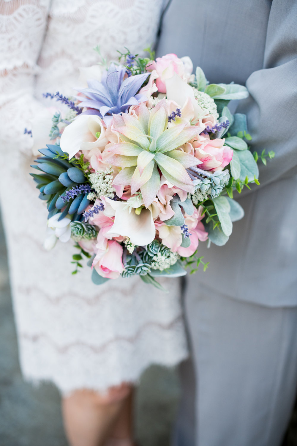 succulent bouquet with pink purple green blue